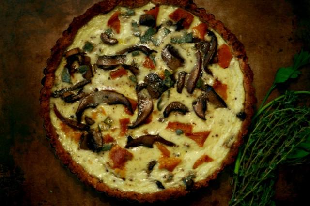A delicious Fall quiche with squash and portobello mushrooms nestled in a rosemary raisin crust.